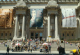 View of main entrance with people showing, left to right, banners for the exhibitions The Michael...